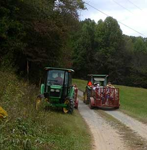 Tractors and wagons meet in the road
